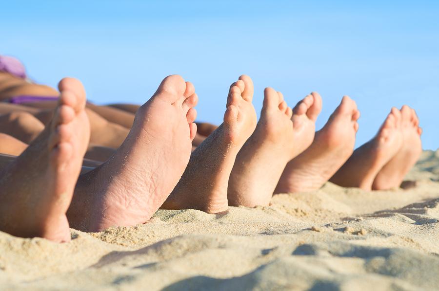 bigstock-Closeup-of-feet-row-lying-in-l-43071631