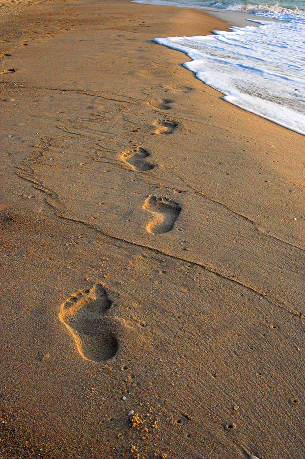 bigstock-Footprints-In-The-Sand-1502144
