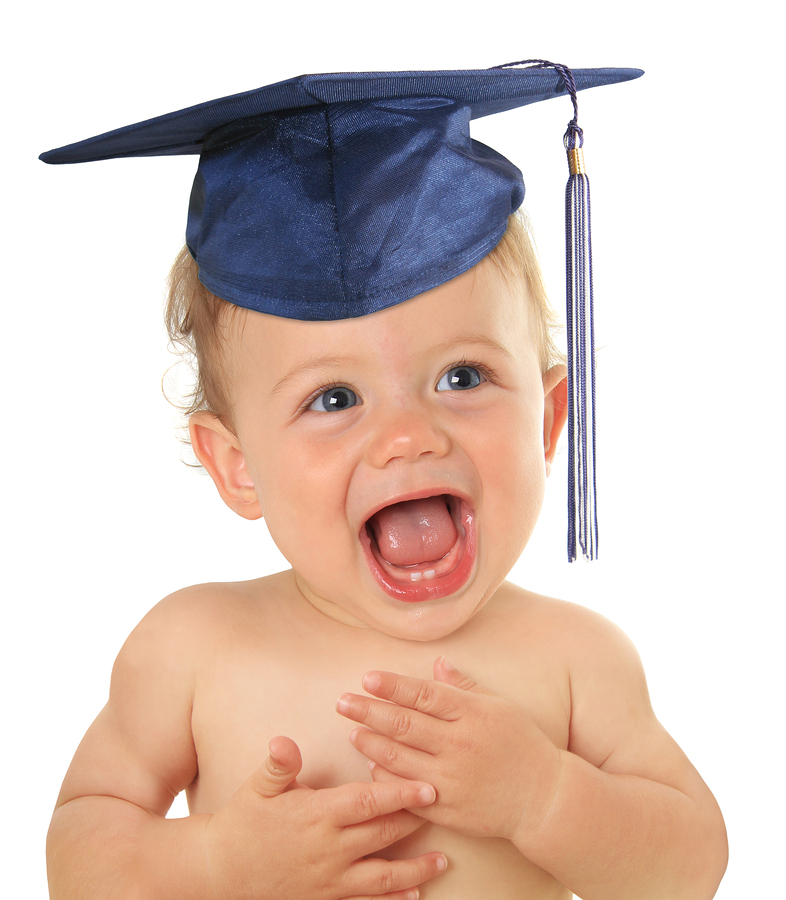 Adorable ten month old baby wearing a graduation mortar board.